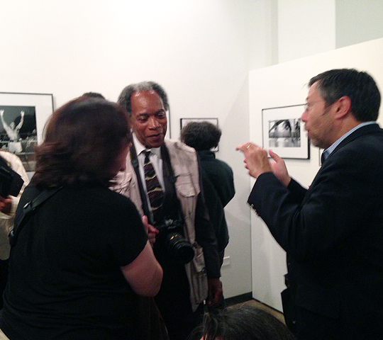 Pulitzer Prize-winning photojournalist John White talks to admirers